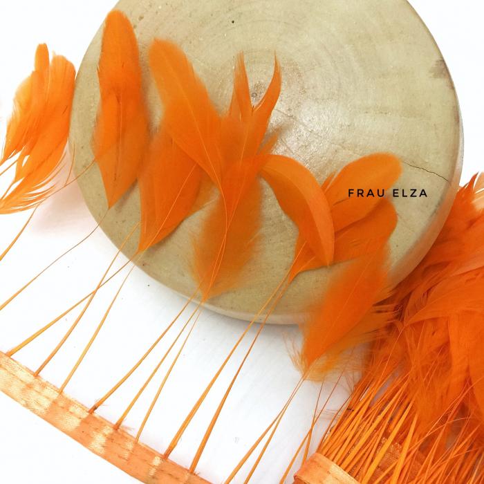 Перья петуха на ножках, оранжевые